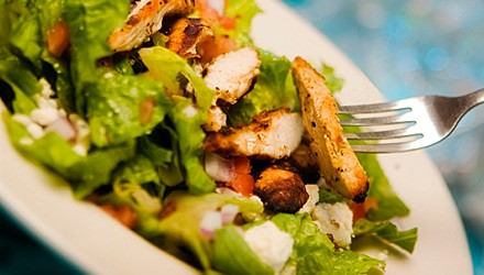 Chicken dinner salad with green onion dressing