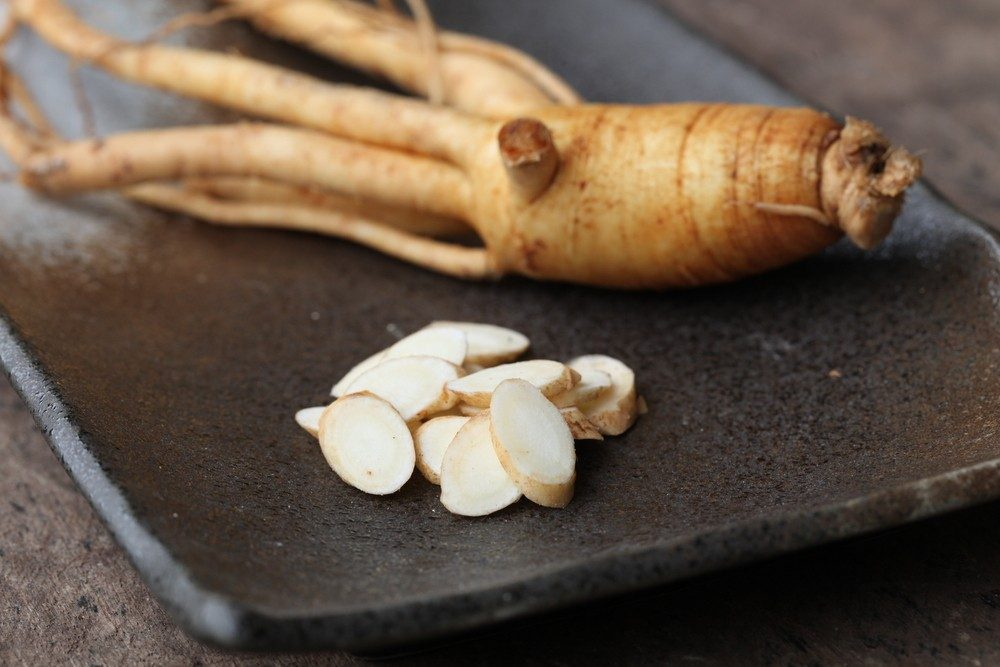 Ginseng with roots and sliced pieces
