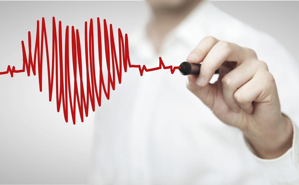 Man drawing heart chart -- Research Highlights Angioplasty Risks in People With Diabetes