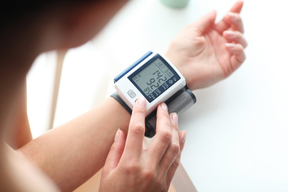 Woman taking her blood pressure -- Monitoring Blood Pressure With Type 1 Diabetes
