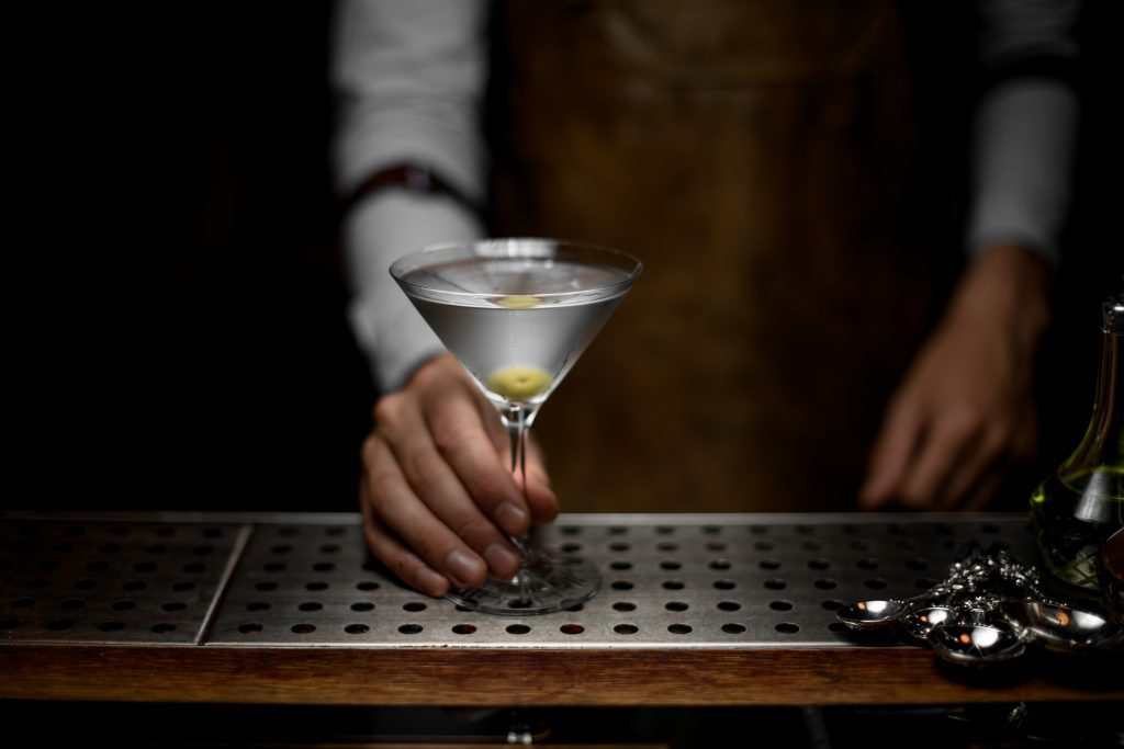 Bartender holding glass -- Holiday Party Tips for Diabetics