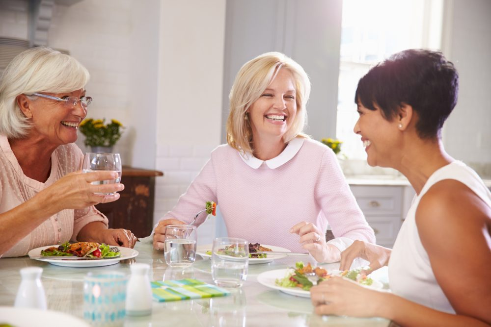 Middle age women enjoying a meal -- Menopause and Nutrition