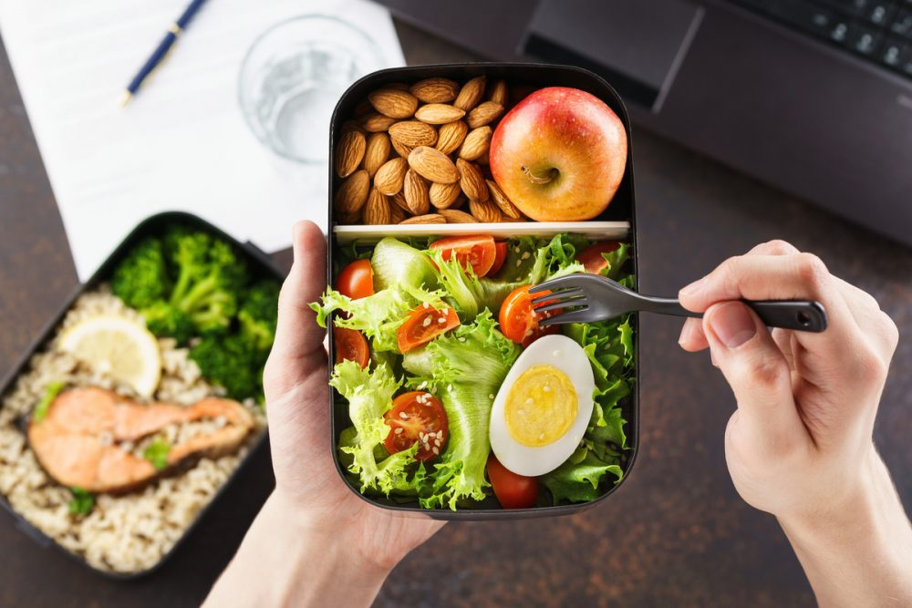 Person eating healthy lunch -- Packed Lunch Ideas