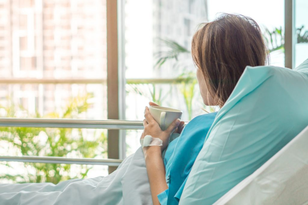 Woman in hospital bed -- What Is a Pressure Sore & How to Prevent One