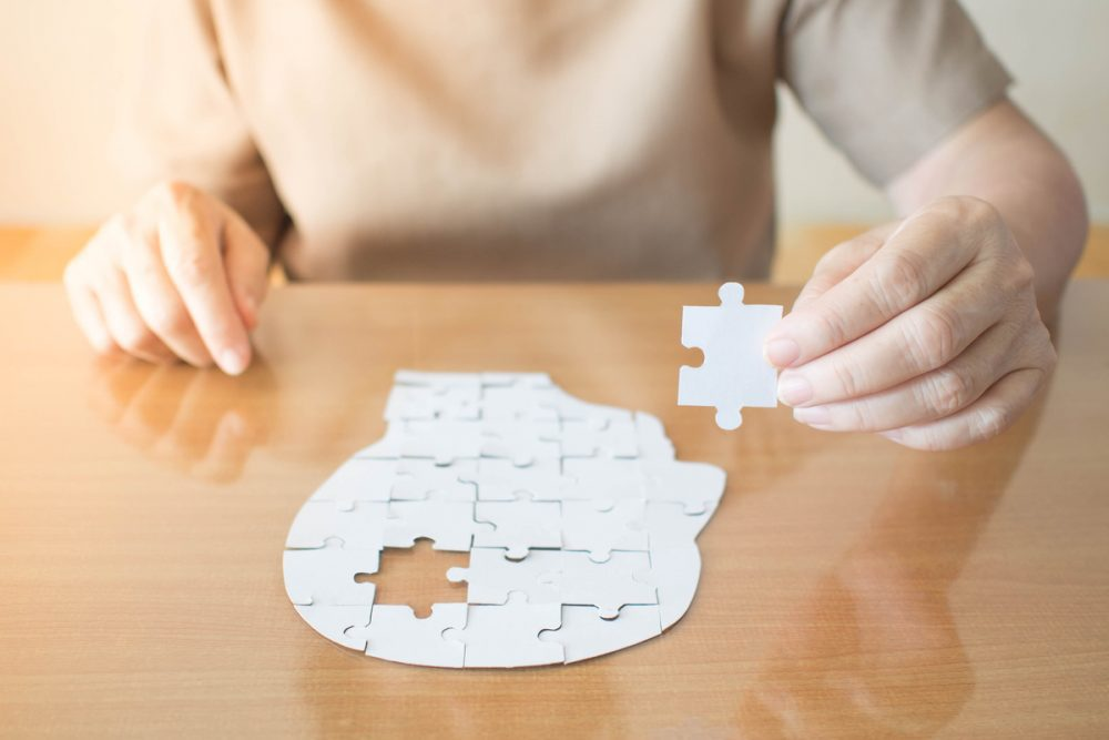 Woman putting together puzzle -- Very Low Blood Glucose Reduces Cognitive Ability in Older Adults With Type 1: Study