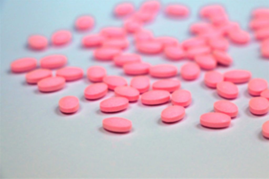 Pink pills on table -- Diabetes and Steroids: Can People With Diabetes Take These Medicines?