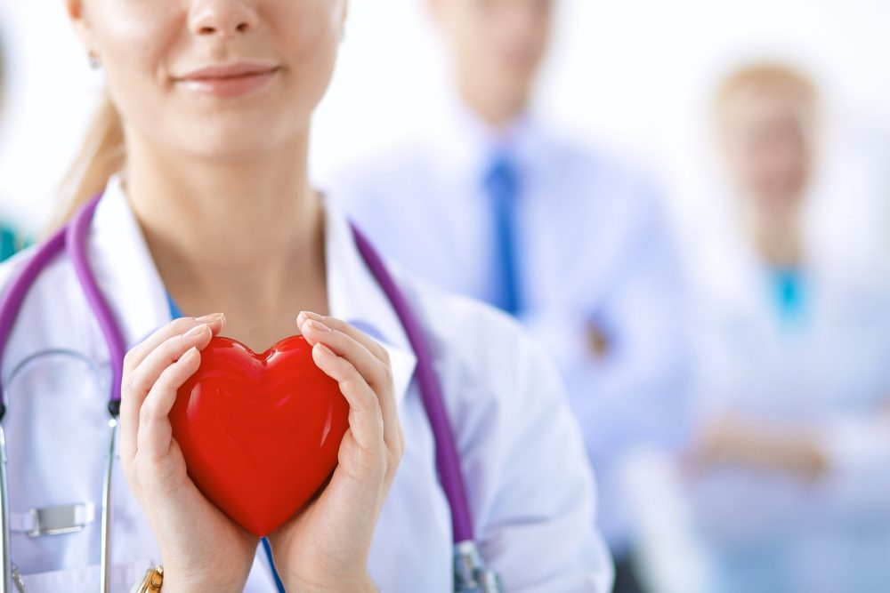 Doctor holding heart shape -- Tips for a Healthy Heart