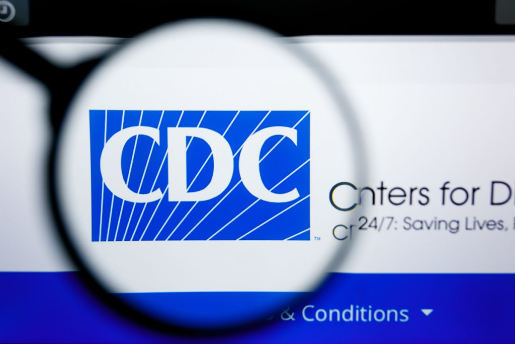 Magnifying glass over word CDC -- Avoiding Coronavirus With Diabetes