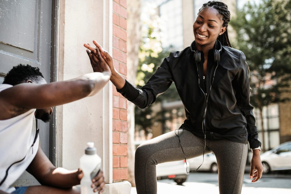 Fitness partners high-fiving -- Mental Contrasting for Diabetes Management