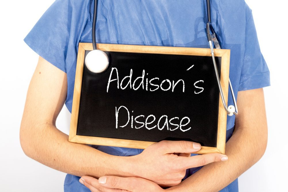 Doctor holding sign saying Addison's disease -- Type 1 Diabetes and Addison's Disease: What's the Connection?